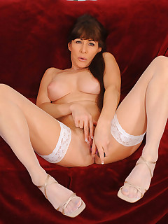 Busty Alexandra Silk inserts a dildo deep inside her pussy