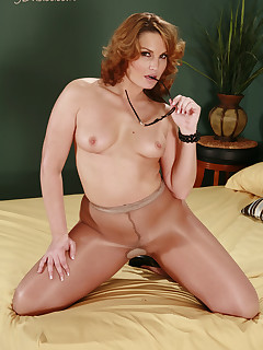 Naughty teacher in pantyhose brings us to a hotel so she can show us her top class figure.