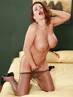 Sultry mature mom modeling her beautiful legs in pantyhose.