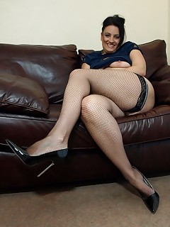 Horny big ass mommy in fishnet stockings shows off her juicy pussy.
